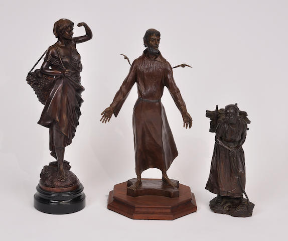 A group of three patinated bronze figures: St. Francis of Assisi and two peasant women 20th century