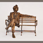 A patinated bronze sculpture of Mark Twain on a park bench<BR />by Gary Price<BR />end of 20th century