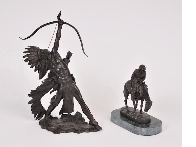 Two patinated bronze sculptures of a cowboy and an Indian<BR />20th century