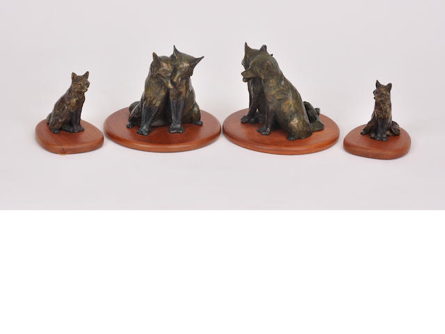 A group of four patinated bronze sculptures of seated foxes<BR />by Forest Hart<BR />late 20th century