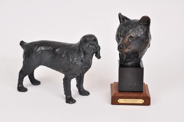 Two patinated bronze sculptures of a spaniel and a bear head