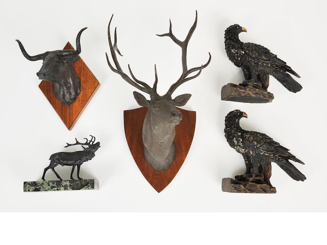 A group of five patinated metal and patinated composition sculptures of animals