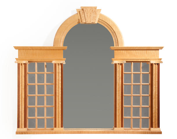 A contemporary birch and mahogany over-dresser mirror