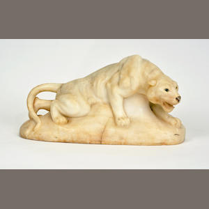 A modern alabaster sculpture of a mountain lion