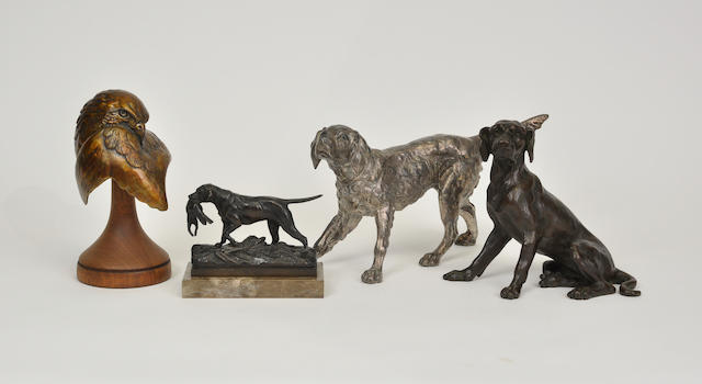 A group of four bronze and metal sculptures of dogs and a hawk late 19th to late 20th century