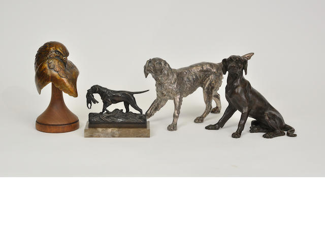 A group of four bronze and metal sculptures of dogs and a hawk<BR />late 19th to late 20th century