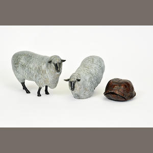 A group of three patinated metal sculptures of sheep and a tortoise. late 20th century