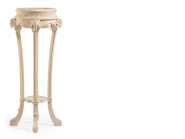 An Adams style carved and cream painted jardinière stand
