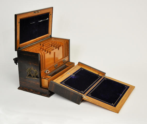 A Victorian tortoise shell and birch wood portable secretary desk<BR />mid-19th century<BR />the ink bottle lids inscribedParkins & Gotto/London