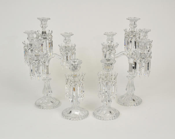 A pair of Victorian style molded glass four light candelabra