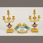 A Sevres style celeste bleu gilt metal mounted and painted porcelain standish and a pair of similar three-light candelabra