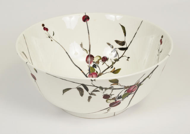 A Royal Doulton glazed earthenware punchbowl designed by Andrew Wyeth printed with fruiting plum branches