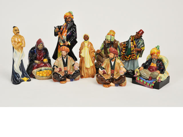 Nine Royal Doulton glazed earthenware figures of Arab characters