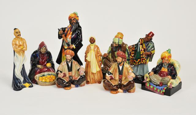 Nine Royal Doulton glazed earthenware figures of Arab characters
