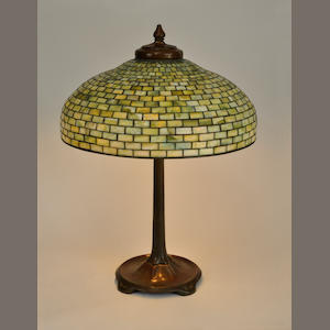 A Tiffany Studios Favrile glass and patinated bronze Geometric table lamp. first quarter 20th century
