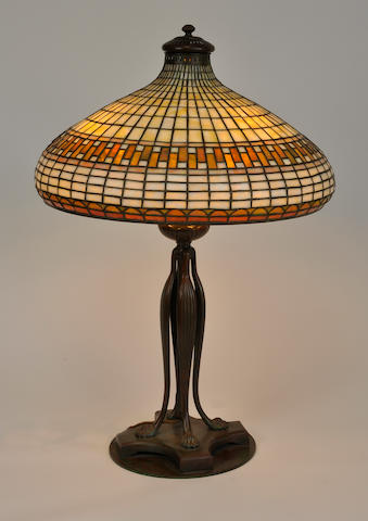 A Tiffany Studios Favrile glass and patinated bronze Geometric table lamp<BR />first quarter 20th century<BR /> **AUTHENTICIY OF THE BASE TO BE CONFIRMED**