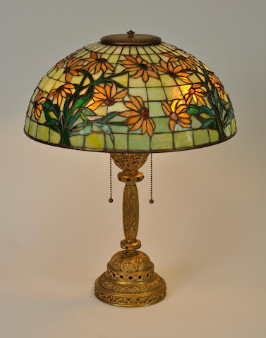 A Tiffany Studios Favrile glass and gilt-bronze<BR />first quarter 20th century<BR /> **AUTHENTICIY OF THE SHADE TO BE CONFIRMED**