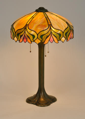 A Duffner and Kimberly and J.A. Whaley leaded glass and patinated bronze table lamp<BR />first quarter 20th century