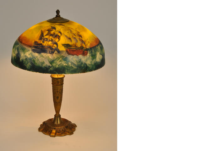 An American reverse-painted glass and gilt metal table lamp<BR />first quarter 20th century