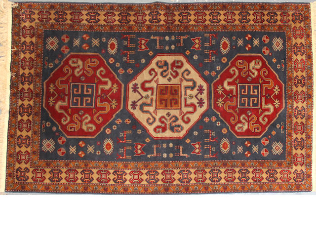 A Turkish rug  size approximately 4ft. 5in. x 7ft.