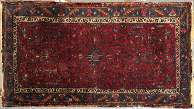 A Hamadan rug size approximately 3ft. 6in. x 6ft. 4in.