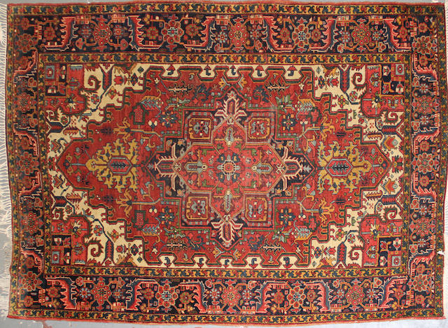 A Heriz carpet size approximately 7ft. 6in. x 10ft. 3in.