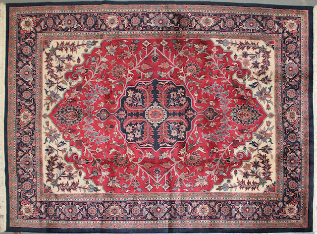 An Indian carpet  size approximately 8ft. 10in. x 11ft.