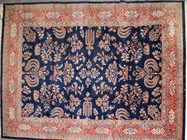 An Indian carpet  size approximately 9ft. 11in. x 13ft. 9in.