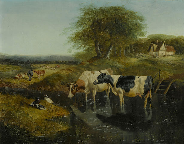 John Frederick Herring, Jnr. (British, 1815-1907) A landscape with cows in a pond 14 x 18in (35.5 x 45.7cm)
