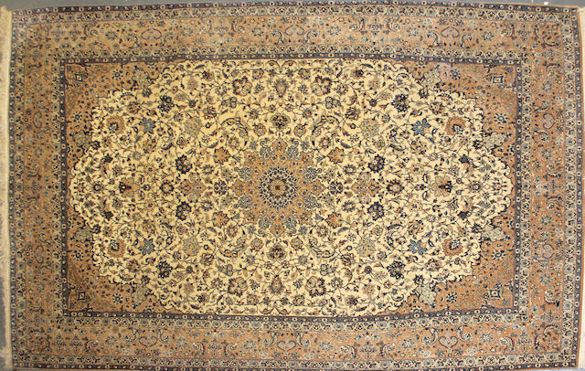 A Nain carpet  size approximately 8ft. 11in. x 11ft. 11in.