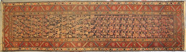 A Malayer runner size approximately 3ft. 3in. x 12ft. 2in.