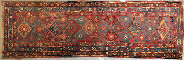 A Kurdish runner size approximately 3ft. 3in. x 10ft.