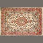 A Tabriz carpet  size approximately 10ft. 1in. x 6ft. 7in.