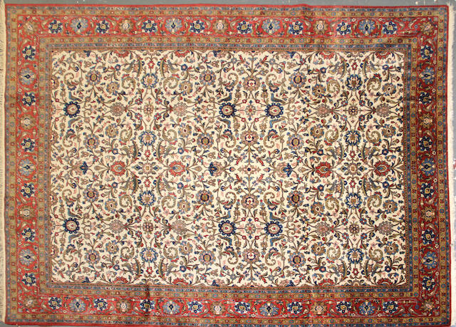An Isphahan carpet size approximately 7ft. 8in. x 11ft.