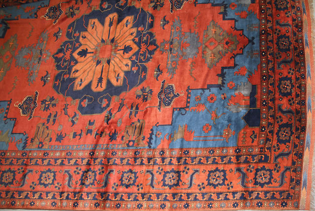 An Afghan carpet  size approximately 13ft. 4in. x 17ft. 8in.