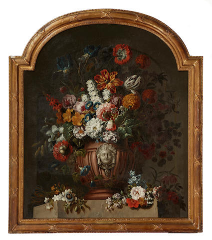 Gaspar Pieter Verbruggen the Younger (Antwerp 1664-1730) A still life with tulips, irises and other flowers in an urn arched top, 50 1/2 x 42 1/2in (128.2 x 107.9cm)