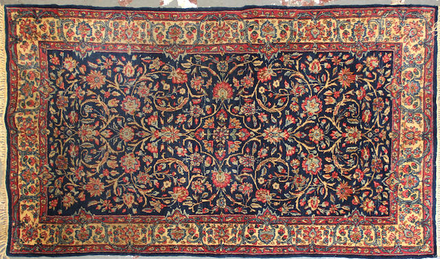 A Kerman rug  size approximately 3ft. 11in. x 6ft. 9in.