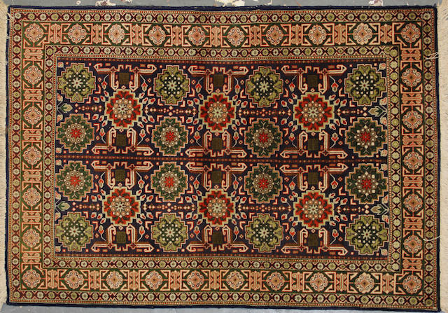 A Tabriz rug size approximately 3ft. 4in. x 4ft. 10in.