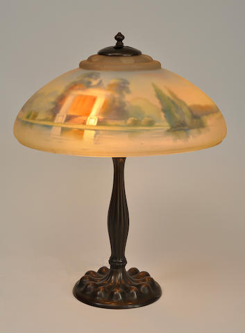 A Pairpoint and Duffner and Kimberly reverse-painted glass and patinated metal scenic table lamp first quarter 20th century
