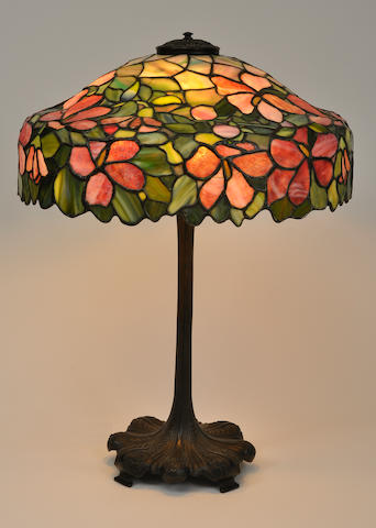 A Unique Art Glass leaded glass and patinated metal Hibiscus table lamp <BR />first quarter 20th century