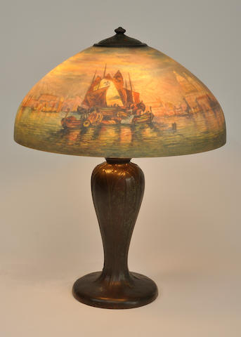 A Handel reverse-painted glass and patinated metal San Marco table lamp<BR />model 6757, first quarter 20th century