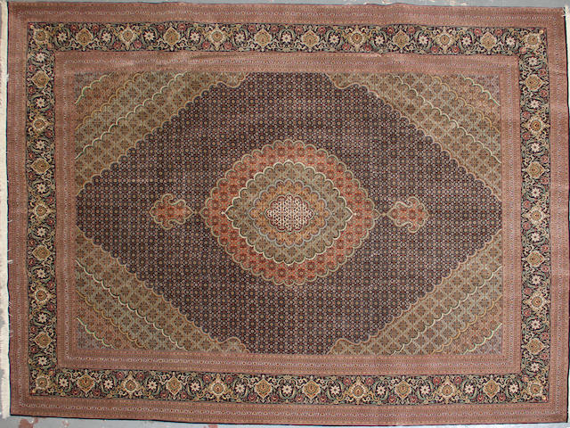 A Tabriz carpet size approximately 9ft. x 12ft.