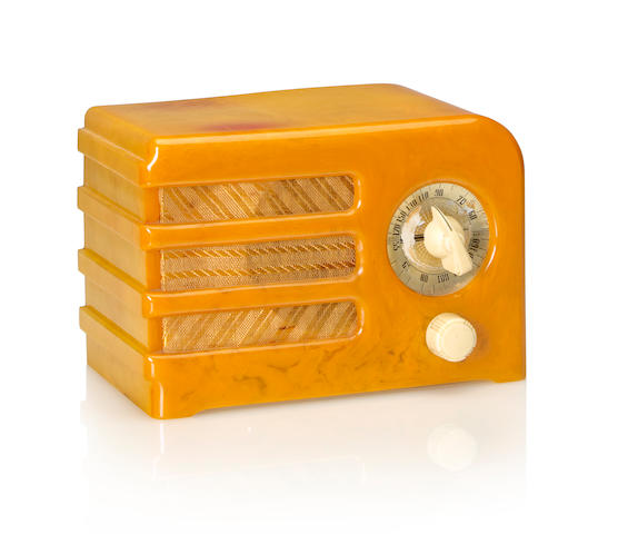 A Halson A5 1938 Yellow case with white knobs.  height 5in (12.8cm); length 7 1/2in (19cm); depth 4 1/4in (10.8cm)