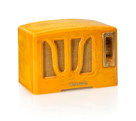 An RCA RC-350 1938 Yellow case with white knobs, RCA decal. height 4 3/4in (12cm); length 7in (17.8cm); depth 4 1/4in (10.8cm)