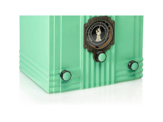 An Air King Skyscraper 52 Designed by Harold Van Doren, circa 1933 Mint green case with green on black knobs and a map of the world dial.  height 11 3/4in (29.8cm); width 8 3/4in (22.4cm); depth 6 3/4in (17cm)