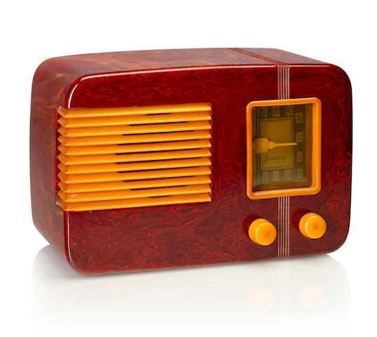 A Sentinel 177U 1939 Marbleized burgundy case with yellow knobs, dial bezel and grille. height 6 3/4in (17.2cm); length 10 1/4in (26cm); depth 5 1/4in (13.4cm)