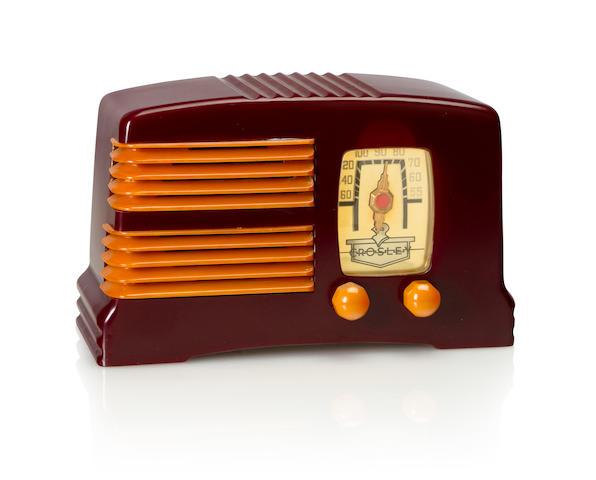 A Crosley G-1465 Split Grille 1938 Maroon case with yellow knobs and split grille. height 5 3/4in (14.5cm); length 9 /8in (23.8cm); depth 3 3/4in (9.5cm)