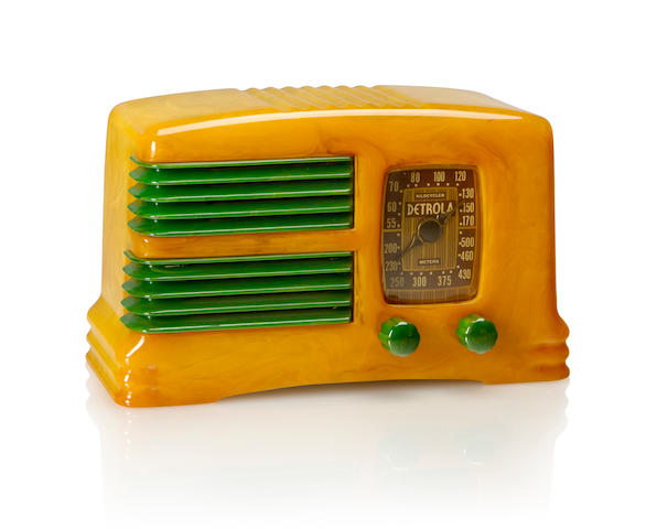 A Detrola 281 Split Grille 1939 Marbleized yellow case and emerald green split grille and matching knobs, with remnant of paper label. height 5 1/4in (13.5cm); length 9 1/4in (23.5cm); depth 3 7/8in (10cm)