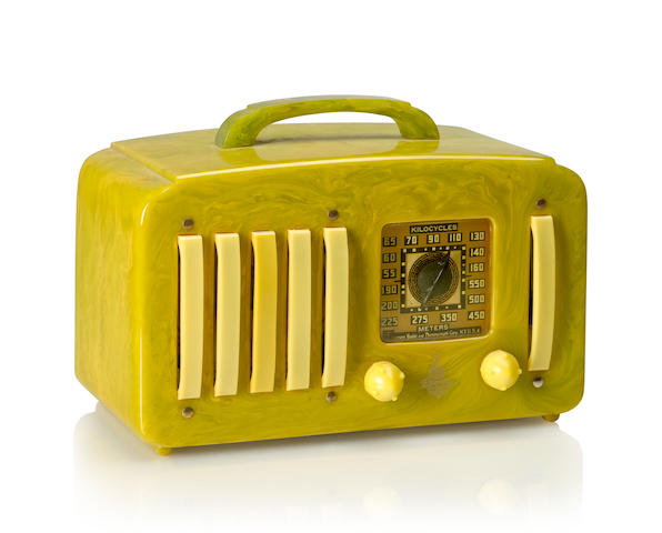 An Emerson EP375 Five Plus One 1941 Lime case and handle, with yellow knobs and grille, metal rivets and Emerson decal. height 5 3/4in (14.6cm); length 9 1/2in (24.2cm); depth 4 7/8in (12.4cm)