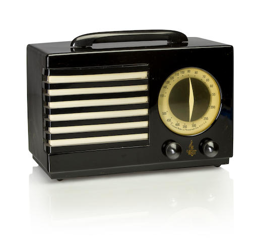 An Emerson 400 Aristocrat 1940 Black case with black handle, knobs and black and white grille, with Emerson decal. height 7 1/4in (18.5cm); length 10 7/8in (27.6cm); depth 5 3/8in (13.6cm)